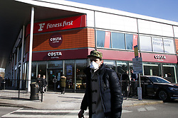 © Licensed to London News Pictures. 23/03/2020. London, UK. A man wearing a face mask walks past Costa Coffee in Haringey north London. Costa Coffee  across the UK are to close from 7pm tonight as the spread of the coronavirus continues in the country. Photo credit: Dinendra Haria/LNP
