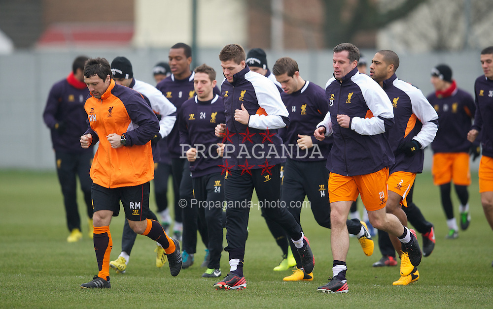 LIVERPOOL, ENGLAND - Wednesday, February 20, 2013: Liverpool's head of fitness and science Ryland Morgans, captain Steven Gerrard, Jamie Carragher during a training session at Melwood Training Ground ahead of the UEFA Europa League Round of 32 match against FC Zenit St Petersburg. (Pic by David Rawcliffe/Propaganda)