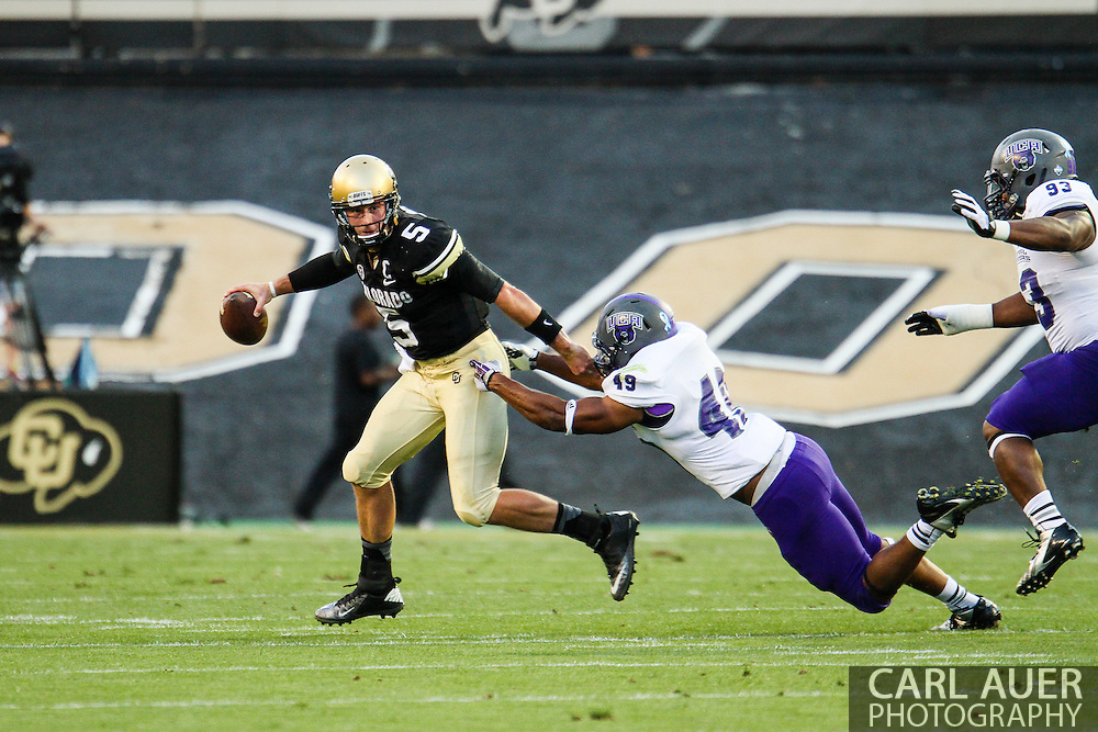 September 7th, 2013 - Colorado Buffaloes junior quarterback Connor Wood (5) breaks a tackle by University of Central Arkansas Bears senior linebacker Justin Heard (49) in the first half of the NCAA football game between the University of Central Arkansas Bears and the University of Colorado Buffaloes at Folsom Field in Boulder, CO