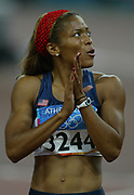 LaTasha Colander of the United States looks at the scoreboard after placing eighth in the women's 100 meters in 11.18 in the 2004 Olympics in Athens, Greece on Satuday, August 21, 2004.