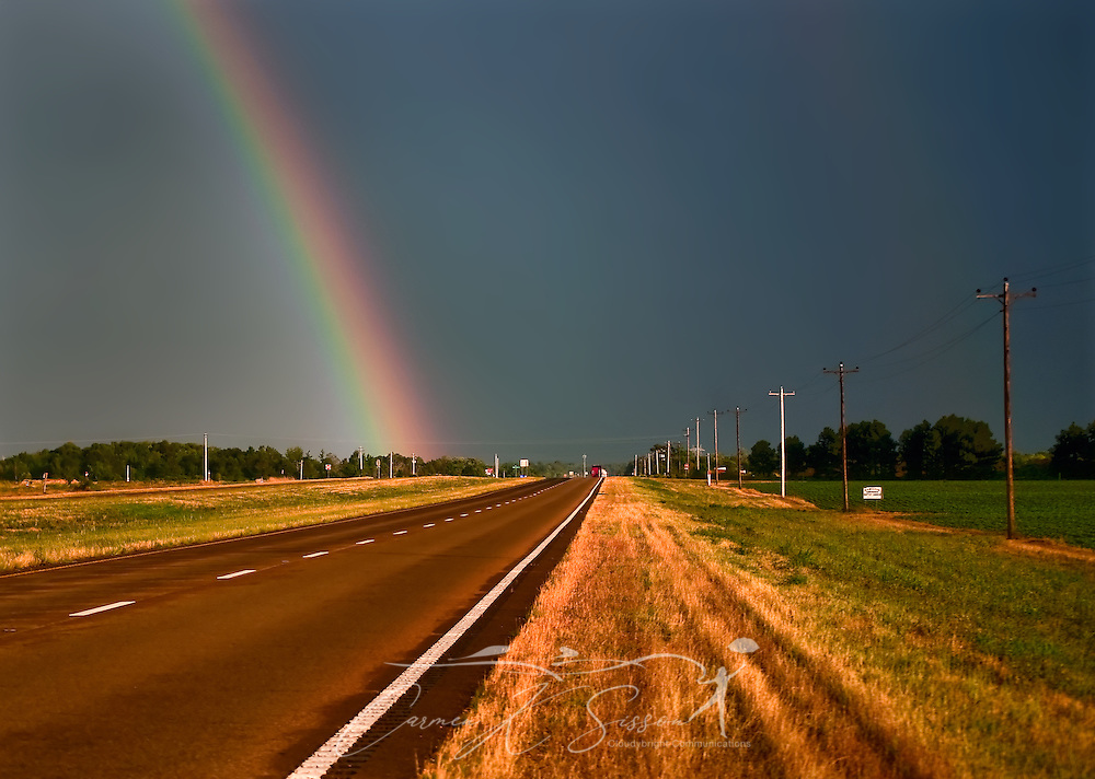 A rainbow appears as a storm approaches on Highway 45 South in Columbus, Mississippi, June 24, 2011. (Photo by Carmen K. Sisson/Cloudybright)