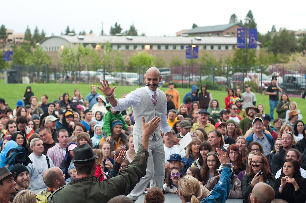 Giovanni Dominice hi-fives the crowd in Bend, Oregon on Saturday, June 5, 2010 at the Beard Team USA National Beard and Mustache Championships. Dominice was competing in the mustache portion of the competition.