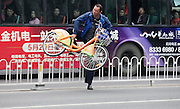 XI'AN, CHINA - OCTOBER 16: (CHINA OUT) <br /> <br /> Crossing Main road is a danger every day<br /> <br /> a man carrying his bike runs for his life across  the road on October 16, 2014 in Xi'an, Shaanxi province of China. 109 passengers used the guard bar to cross the road within 2 hours since there is no pedestrian crossing between a community and a bus station in Xi'an<br /> ©Exclusivepix