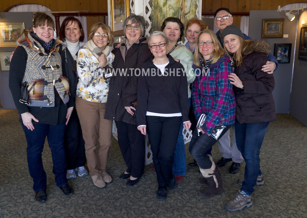 Pine Island, New York - A group photo of the volunteers who set up artwork for the Orange County Arts Council Member Show at the former Jolly Onion Inn on  March 26, 2014.