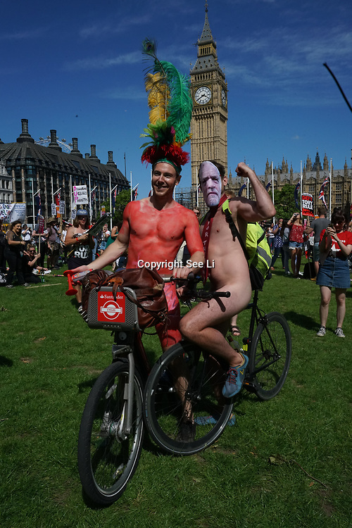 London,England,UK. 10th June 2017. The World Naked Bike Ride passing Westminster, London, UK