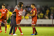 Gabriele Cioffi, Head Coach of Crawley Town FC celebrates the win for Crawley with Beryly Lubula (Crawley Town) & Filipe Alexandre Morais (Crawley Town) following the EFL Cup match between Crawley Town and Norwich City at The People's Pension Stadium, Crawley, England on 27 August 2019.