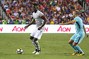 Manchester United Midfielder Paul Pogba takes on Barcelona Andres Iniesta during the International Champions Cup match between Barcelona and Manchester United at FedEx Field, Landover, United States on 26 July 2017.