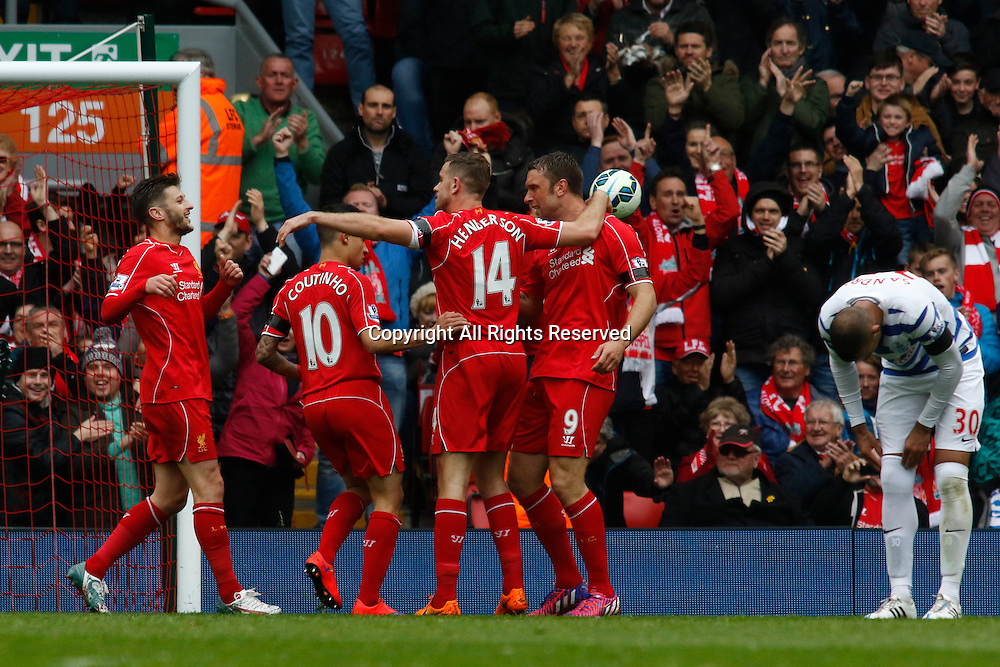 02.05.2015.  Liverpool, England. Barclays Premier League. Liverpool versus Queens Park Rangers. Liverpool midfielder Philippe Coutinho is congratulated by his team mates after scoring the first goal for Liverpool.