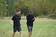 Washington Huskies assistant coach Chris Kwiatkowski (l) and head track and cross country coach Andy Powell share thoughts moments before the men's 4 mile run at the UW/Seattle University Open race at Warren G. Magnuson Park., Friday, Aug. 30, 2019, in Seattle. (Paul Merca/Image of Sport)
