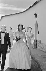 Bride and some members of the bridal party walking on the street in Italy