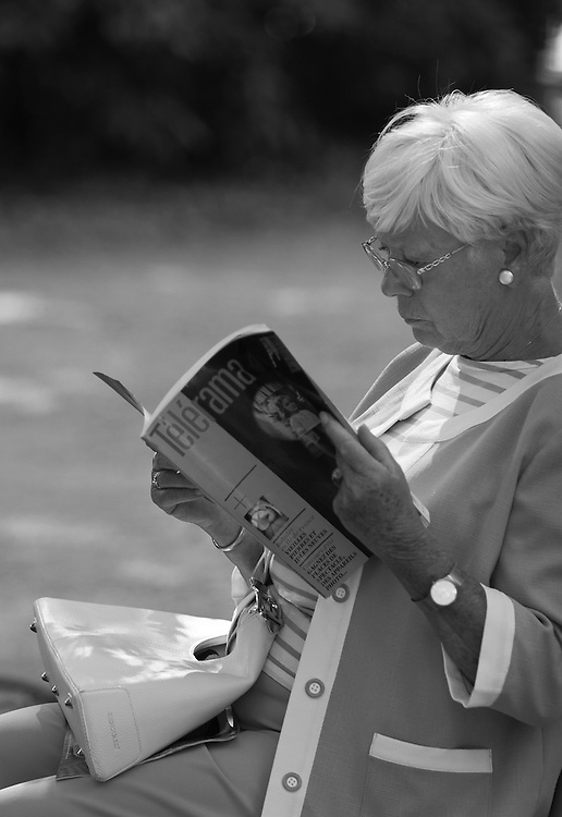 "Black and white photograph of a woman reading in Paris park by Karl R Lilliendahl. This photo is available as Open and Limited Edition Giclee Print in four different sizes. Click on ""Get Print"" to see more details."