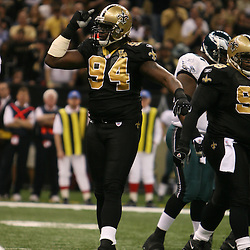 13 January 2007: New Orleans Saints defensive end Charles Grant (94) celebrates during a 27-24 win by the New Orleans Saints over the Philadelphia Eagles in the NFC Divisional round playoff game at the Louisiana Superdome in New Orleans, LA. The win advanced the New Orleans Saints to the NFC Championship game for the first time in the franchise's history.