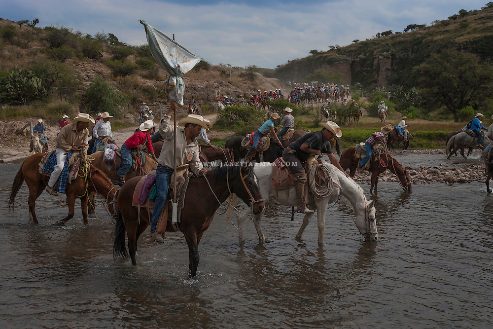 Pilgrims on horseback take a water break as they travel to the Church of San Martin Caballero in Mexico's Guanajuato state, where they will have their horses blessed by priests on November 11. Each year they make the trek, by foot and by horseback, traveling for up to three days to reach the town of San Martin de Los Terreros, where the church is located. San Martin is the patron saint of horses and was buried on November 11, around 400 A.D.