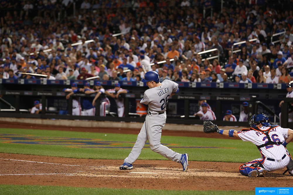 NEW YORK, NEW YORK - May 29:  Chase Utley #26 of the Los Angeles Dodgers breaks his bat on contact with the ball while batting during the Los Angeles Dodgers Vs New York Mets regular season MLB game at Citi Field on May 29, 2016 in New York City. (Photo by Tim Clayton/Corbis via Getty Images)