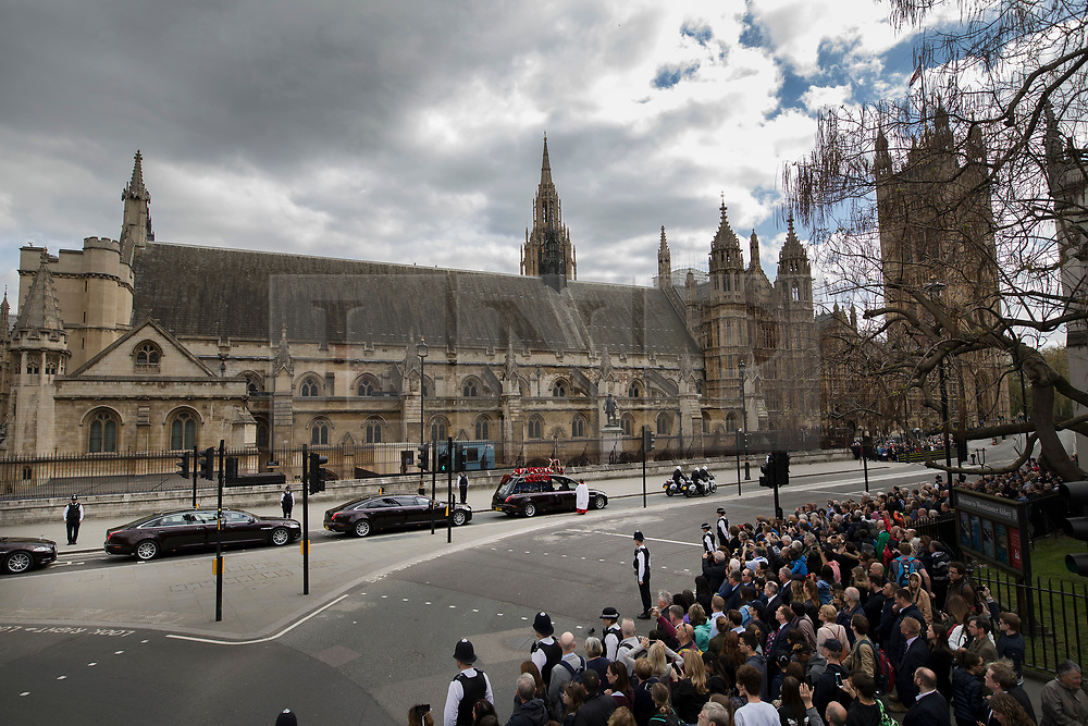 © Licensed to London News Pictures. 10/04/2017. London, UK. The funeral cortege carrying the coffin of policeman Keith Palmer leaves the Palace of Westminster.  PC Palmer was murdered just inside the front gate by Westminster attacker Khalid Masood - an attack in which he also killed four people on Westminster Bridge. PC Palmer's funeral will take place at Southwark Cathedral today. Photo credit: Peter Macdiarmid/LNP