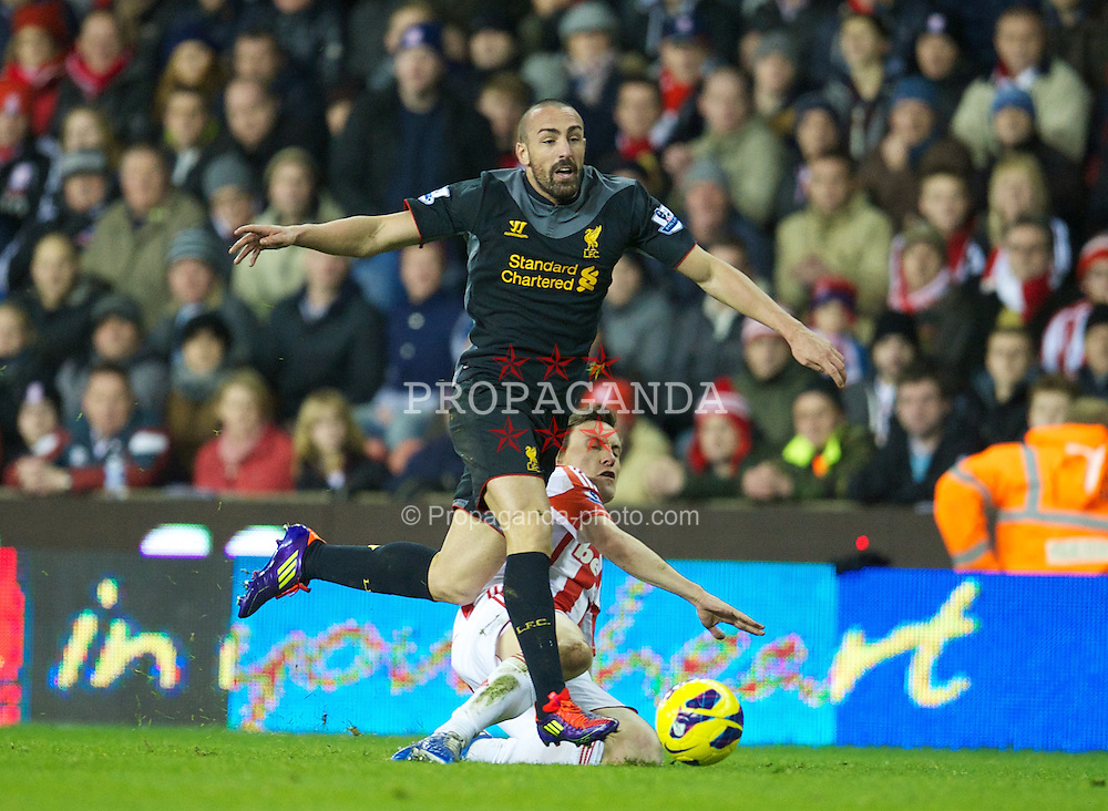 STOKE-ON-TRENT, ENGLAND - Boxing Day Wednesday, December 26, 2012: Liverpool's Jose Enrique in action against Stoke City during the Premiership match at the Britannia Stadium. (Pic by David Rawcliffe/Propaganda)