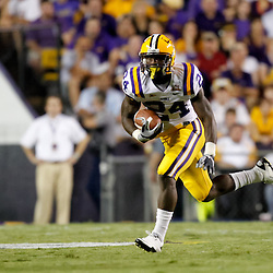 Sep 25, 2010; Baton Rouge, LA, USA; LSU Tigers running back Alfred Blue (24) runs against the West Virginia Mountaineers during the first half at Tiger Stadium.  Mandatory Credit: Derick E. Hingle