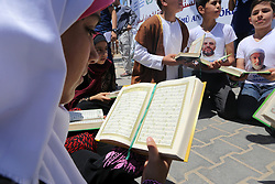 May 31, 2017 - Gaza, Gaza strip, Palestine - Palestinian children read copies of Koran during a rally to mark the 7th anniversary of the Mavi Marmara Gaza flotilla incident, at the seaport of Gaza City May 31, 2017. Nine activists, eight Turkish and one Turkish-American, died on May 31, 2010, when Israeli commandos raided the Mavi Marmara ship, which was part of a flotilla seeking to break the blockade imposed on the Gaza Strip. (Credit Image: © Momen Faiz/NurPhoto via ZUMA Press)