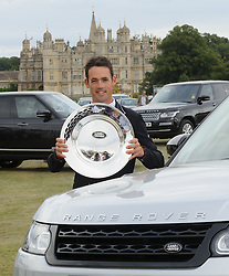 New Zealand's Jonathan Paget wins Burghley. <br /> Jonathan Paget holding the Land Rover Trophy in front of Burghley House- Burghley House, Stamford, UK, Sunday, 8th September 2013. Picture by  Nico  Morgan / i-Images