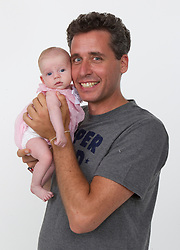 "EXCLUSIVE: For lesbian couples and single ladies looking to have a baby without the expense of going through a sperm bank (which can run in the thousands of dollars), Ari Nagel is the No. 1 dad. About half the time, he provides his seed the old-fashioned way. Sometimes, a lesbian looking to conceive will have her partner in the bed for moral support while she and Nagel engage in intercourse. ""She's never slept with a guy before, so the partner's in bed, holding her hand,"" Nagel explains. ""Sometimes, it could be a little painful, then after a few times, they're comfortable to do it on their own."" Other times, he supplies his goods in a cup, which he prefers. Nagel made his first foray into professional baby-making eight years ago with a friend — a single, straight Jewish woman in her late 30s and living on the Upper West Side. ""I actually tried to fix her up. I had a friend who I thought would be a better match as a sperm donor,"" he says. ""He got cold feet at the last minute."" So Nagel went with the woman to the fertility clinic. Then he helped out two lesbians seeking a donor on Craigslist. Other women have heard about him through friends and Known Donor Registry, a free website for those looking for sperm donors. Women who have used Nagel's services — which he provides for free — say his good looks, personality and high sperm count are a draw. ""He's a lot of fun to be around, he loves people, he's outgoing, and he's gorgeous,"" says Tiffany Harrison, 41, of New Jersey, who with her wife, Yvonne, has a toddler daughter, Zoe, sired by Nagel. As for his own motivations, the big daddy insists he just likes spreading his seed. ""I just love seeing how happy the moms and kids are . . . That's why I do this,"" he says. ""It's the gift that keeps on giving."" **NO NEW YORK DAILY NEWS, NO NEW YORK TIMES, NO NEWSDAY**. 11 Jun 2017 Pictured: 06/11/17 Features, sperm donor, Ari Nagel (and a baby girl he fathered). Brian Zak/"