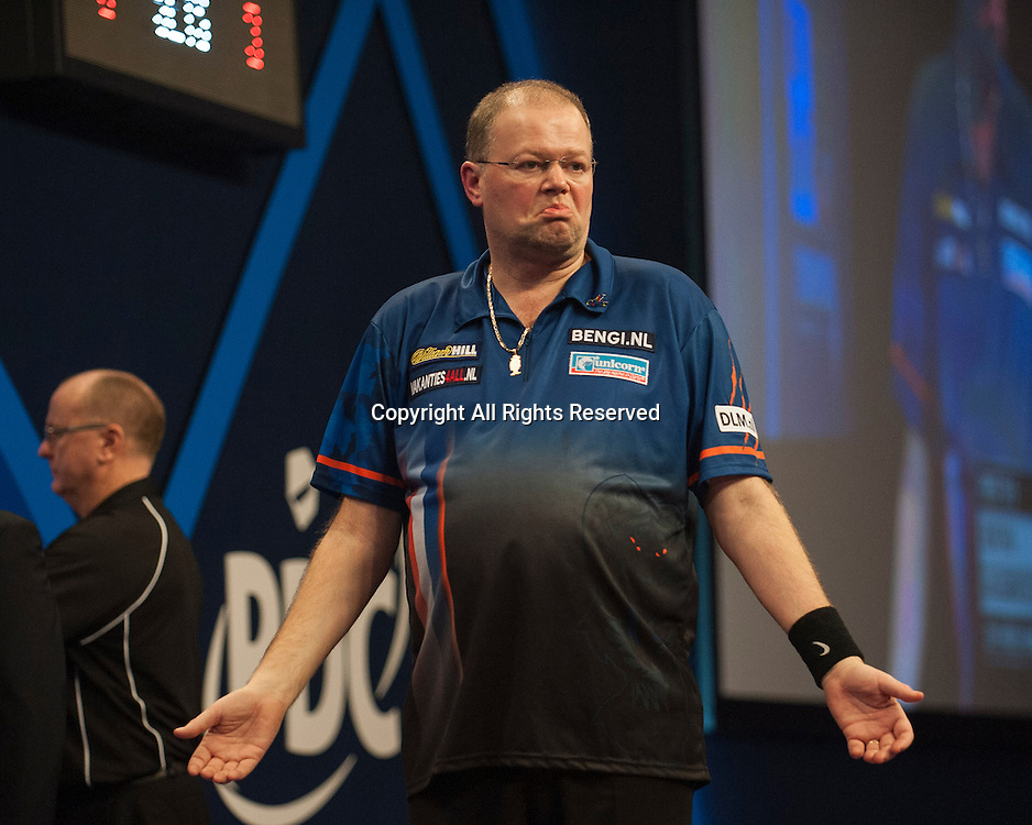 02.01.2014.  London, England.  William Hill PDC World Darts Championship.  Quarter Final Round.  Raymond van Barneveld (14) [NED] celebrates during his game with Stephen Bunting (27) [ENG].  Raymond van Barneveld won the match 5-4