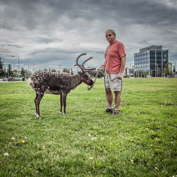 """David Hall with Star the Reindeer on the Delaney Park Strip in downtown Anchorage.  """"I've been friends with Star for 11 years.  I love to take her for walks and show her off to the tourists!""""  -David Hall  david_of_the_lake@hotmail.com"""