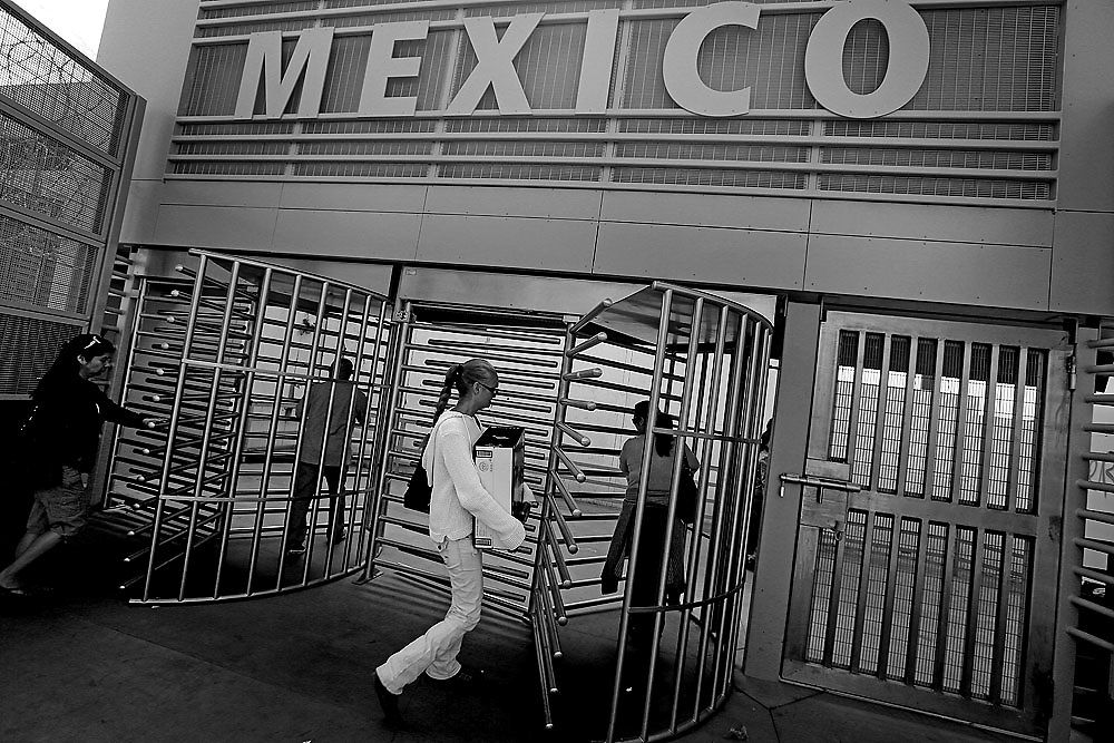 Pedestrians cross the U.S.-Mexico border into Tijuana, Mexico on Sunday, March 3, 2013.  Due to the recent Sequestration cuts, Customs and Border Patrol agents have been given reduced hours leading to longer lines at the World's most busy border crossing.