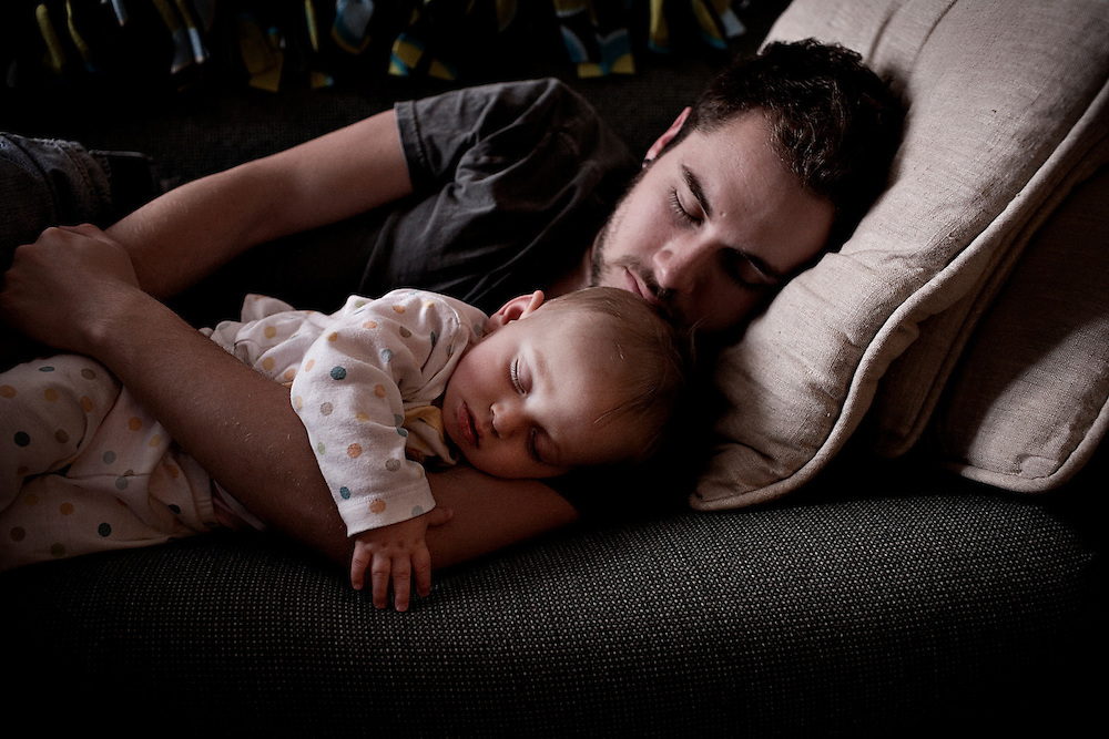 Matt Eich, 21, naps on the sofa next to his daughter Madelyn, 8 months, in Athens, Ohio on Sunday, May 18, 2008.