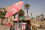 A tourist stall with Coca-Cola umbrella in Luxor Square, Luxor Temple, Nile Valley, Egypt.