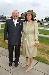 ANTHONY & ANTOINETTE OPPENHEIMER at the King George VI and The Queen Elizabeth Diamond Stakes sponsored by De Beers held at Newbury Racecourse, Berkshie on 23rd July 2005.<br />