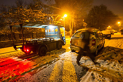© Licensed to London News Pictures . 26/01/2013 . Salford  , UK . A milkman on his early morning round in Salford, Greater Manchester . Heavy snow has fallen overnight in the North West , leading to disruption on roads . Photo credit : Joel Goodman/LNP