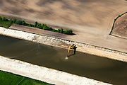 Nederland, Noord-Brabant, Den Bosch, 09-05-2013; werkzaamheden aan de Zuid-Willemsvaart. Het kanaal wordt verbreed, uitgegraven en omgelegd - zodat de binnenstad van Den Bosch vermeden kan worden. Het gaat niet allen om een omlegging, maar ook om een opwaardering zodat grote schepen van het kanaal gebruik kunnen blijven maken.<br /> <br /> QQQ<br /> luchtfoto (toeslag op standard tarieven);<br /> aerial photo (additional fee required);<br /> copyright foto/photo Siebe Swart.
