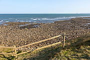 Coastline landscape scenery looking south towards Farne Islands, Holy Island, Lindisfarne, Northumberland, England, UK