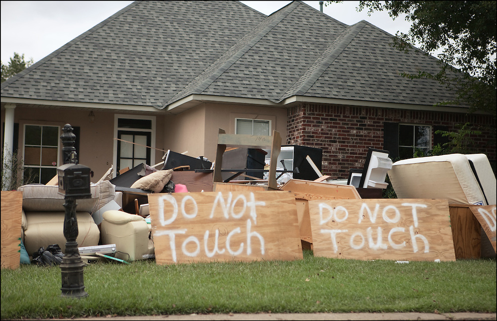 Residents of Walker, Louisiana put signs next to their belongings that are on the curbs after major flooding inundated the town.