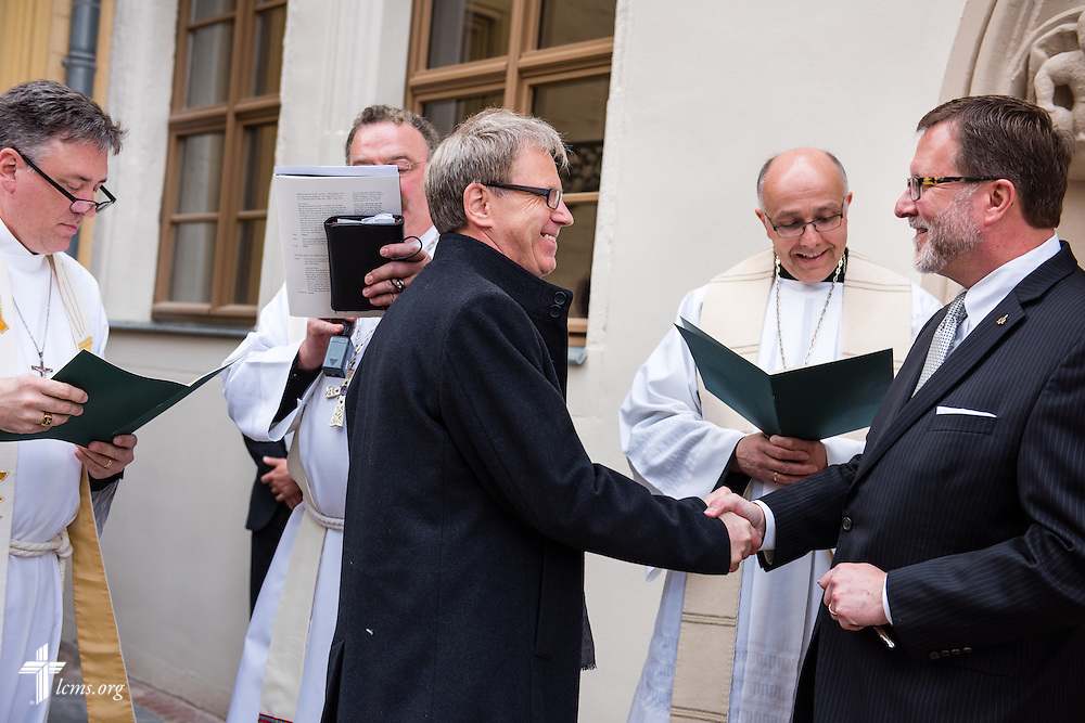Dr. Bruce Kintz, president and CEO of Concordia Publishing House (right), exchanges keys during the dedication of The International Lutheran Center at the Old Latin School on Sunday, May 3, 2015, in Wittenberg, Germany. LCMS Communications/Erik M. Lunsford