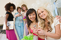 Bride sitting with her Friend showing large engagement ring at Bridal Shower