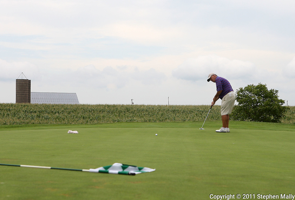 Blayne Hobbs of Anthem, Arizona putts the ball on the sixth hole during the second round of the Greater Cedar Rapids Open held at Hunters Ridge Golf Course in Marion on Saturday, July 23, 2011.
