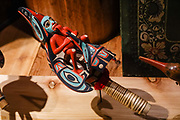 A raven rattle (Yeil sheish oox) made by Tlingit carver Archie Cavanaugh, Jr. in 2009 is displayed in Alaska State Museum, Juneau, USA. The City and Borough of Juneau is the capital city of Alaska and the second largest city in the USA by area (only Sitka is larger). This unified municipality lies on Gastineau Channel in the Alaskan panhandle. Juneau has been the capital of Alaska since 1906, when the government of what was the District of Alaska was moved from Sitka. The city is named after a gold prospector from Quebec, Joe Juneau. Isolated by rugged terrain on Alaska's mainland, Juneau can only be reached by plane or boat. Downtown Juneau sits at sea level under steep mountains up to 4000 feet high, topped by Juneau Icefield and 30 glaciers.