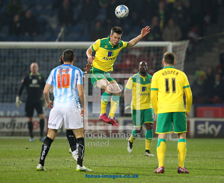 Jonny Howson of Norwich wins a header during the Sky Bet Championship match at the John Smiths Stadium, Huddersfield<br /> Picture by Paul Chesterton/Focus Images Ltd +44 7904 640267<br /> 17/03/2015