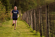 Erik H. runs along a country road in Bucks County, Pa.