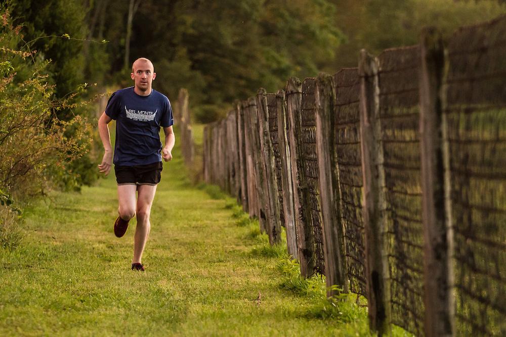 Erik H. runs along a country road in Bucks County, Pa.