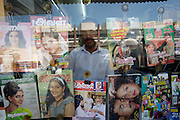 Indian news stand owner at the souq.