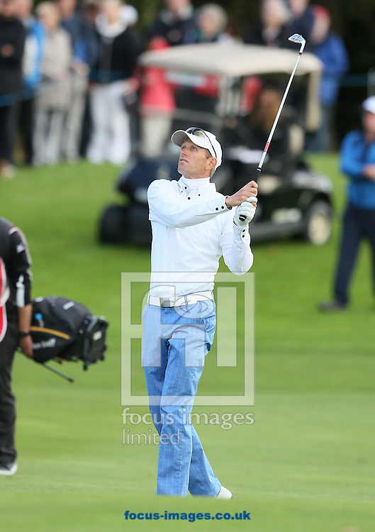 Picture by Paul Gaythorpe/Focus Images Ltd +447771 871632<br /> 06/10/2013<br /> Steen Tinning hits his approach shot to the 18th green in the final round of the English Senior Open at Rockliffe Hall, Darlington.