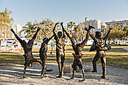 Statue of children playing called Olympic Wannabees Bayfront Park Sarasota, FL.