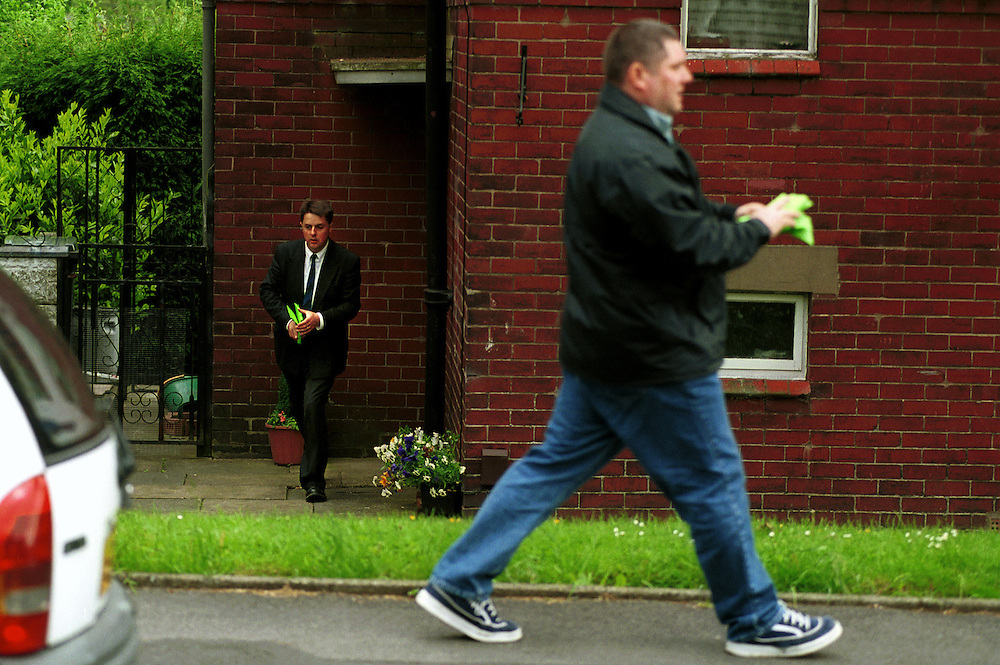 Nick Griffin, who is contesting the Oldham West seat as a candidate for The British National Party in the forthcoming General Election on June 7th, delivers leaflets to largley white neighbourhoods in Oldham with the help of supporters. A graduate of Cambridge University and former member of the National Front, 42 year-old Nick Griffin became the head of The British National Party in 1999.