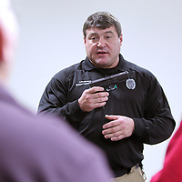 "Adam Robison | BUY AT PHOTOS.DJOURNAL.COM<br /> Robert Carnathan, a lieutenant with the Tupelo Police department, goes over the proper procedure to follow with the gun before going through the ""Shoot-Don't Shoot"" simulator at the Police training center in Tupelo. Tuesday night was the last meeting of the citizen police academy where the participants were put in real life scenarios as officers in a training simulator."