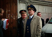 Vyacheslav Raskinsky, Moscow's first deputy prosecutor, walks in front of the apartment of Russian journalist Anna Politkovskaya, murdered in Moscow on 7 October, 2006..Known for her critical coverage of the war in Chechnya, she was shot to death in the elevator of her apartment building in Moscow, in a killing prosecutors believe could be connected to her investigative work..Politkovskaya was a tireless reporter who had written a critical book on Russian President Vladimir Putin and his campaign in Chechnya, documenting widespread abuse of civilians by government troops..Prosecutors have opend a murder investigation into her death, said Svetlana Petrenko, spokeswoman for the Moscow prosecutor's Office. Investigators suspect the killing was connected to the work of the 48-year-old journalist.