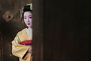 MAIKO GIRL, APPRENTICE GEISHA, KYOTO, JAPAN. Wearing traditional red lipstick, white make-up and kimono. The Gion Geisha district is featured in the 'Memoirs of a Geisha' book, by Arthur Golden, made into a movie by Steven Spielberg.