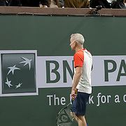 March 1, 2014, Indian Wells, California: <br /> John McEnroe talks to BNP Paribas Open Tournament Owner Larry Ellison between points during the McEnroe Challenge for Charity presented by Esurance. <br /> (Photo by Billie Weiss/BNP Paribas Open)