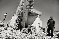 The mayor of Mogadishu, in the ruins of the parliament building in the center of the city.